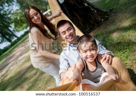 Attractive asian family on a hammock