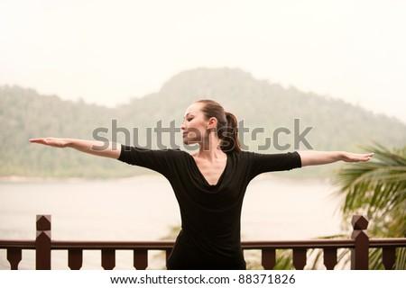 Attractive Asian Female doing yoga - stock photo