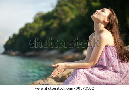 Attractive Asian Female enjoying the beach - stock photo