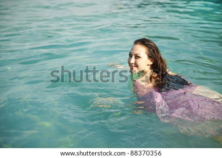 Attractive Asian Female Swimming in the ocean - stock photo