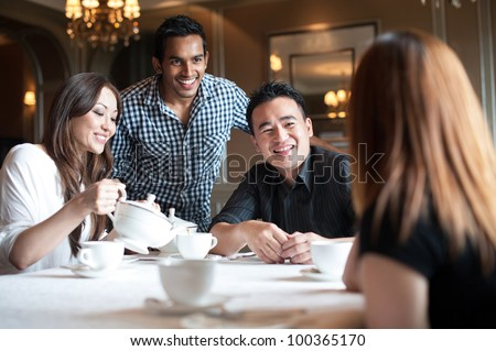 Attractive Asian Friends in Restaurant