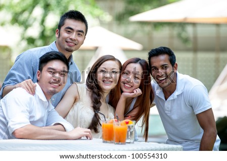 Attractive Asian Friends Outdoor Lifestyle - stock photo