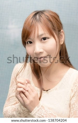 Attractive Asian girl, closeup portrait in modern city.