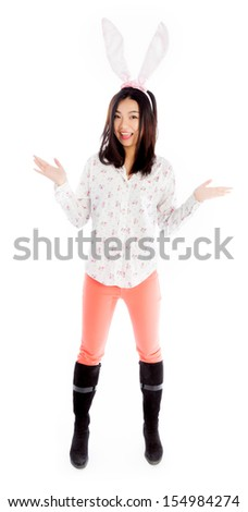 Attractive asian girl in her twenties isolated on a plein background shot in a studio