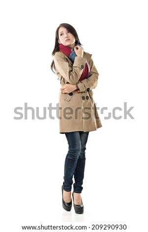 Attractive Asian lady with coat in winter, full length portrait isolated on white background. - stock photo