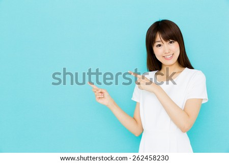 attractive asian nurse showing on blue background