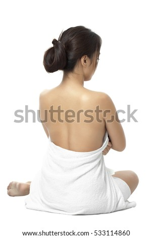 Attractive asian woman at a spa isolated on white background