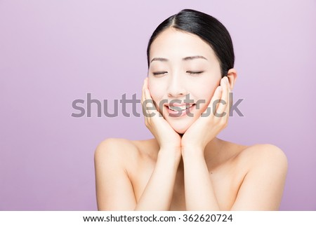attractive asian woman beauty image isolated on purple background - stock photo
