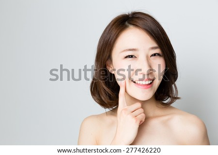 attractive asian woman beauty image on gray background - stock photo
