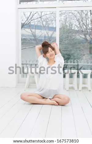 Attractive asian woman doing yoga exercise in the room  - stock photo