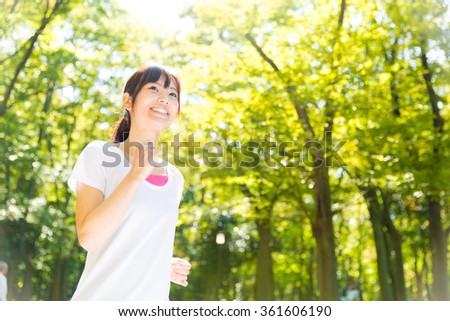 attractive asian woman exercise image - stock photo