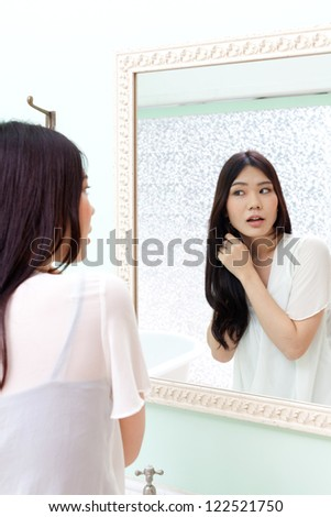 attractive asian woman in the bathroom - stock photo