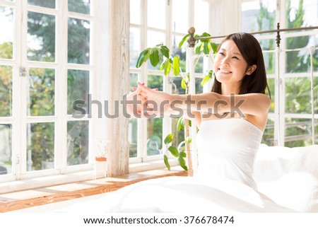 attractive asian woman in the bed - stock photo