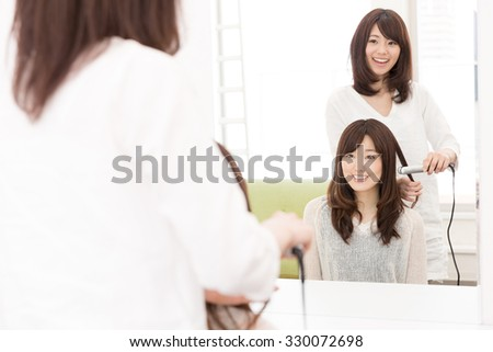 attractive asian woman in the hair salon - stock photo