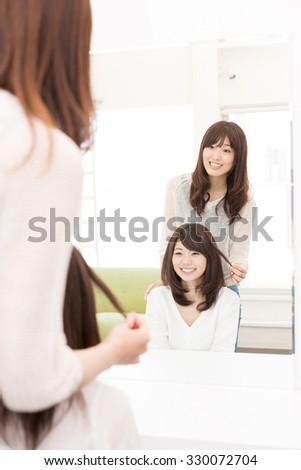 attractive asian woman in the hair salon