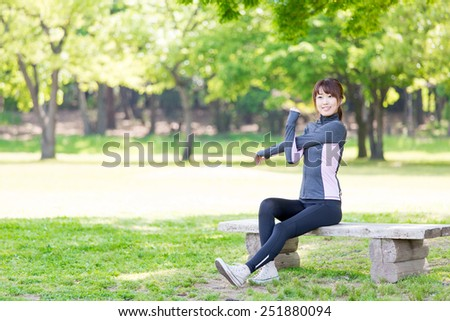 attractive asian woman in the park - stock photo