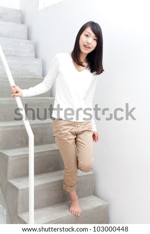 attractive asian woman on the stair - stock photo