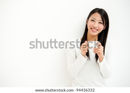 attractive asian woman relaxing all white room - stock photo