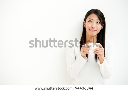 attractive asian woman relaxing all white room