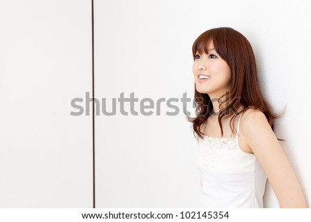 attractive asian woman relaxing in the room - stock photo