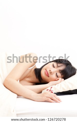 attractive asian woman?sleeping on the bed