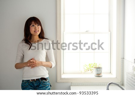 attractive asian woman standing in the bathroom
