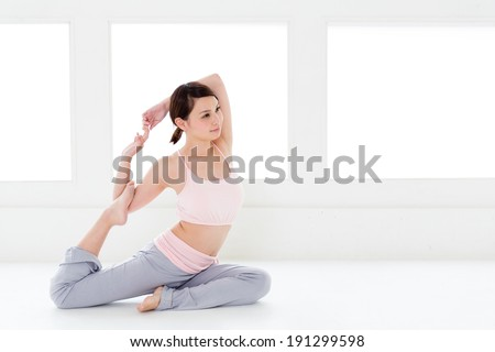 attractive asian woman stretching in the sport gym - stock photo