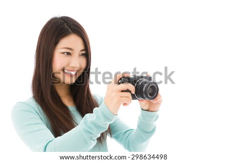 attractive  asian woman taking photo isolated on white background