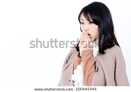 attractive asian woman wearing a coat - stock photo