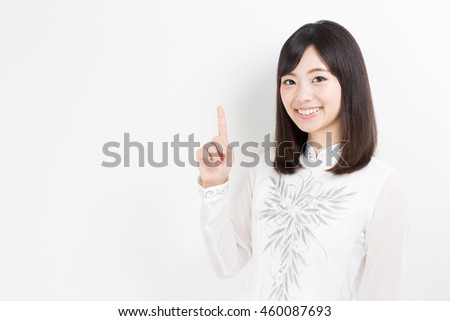 attractive asian woman wearing ao dai isolated on white background