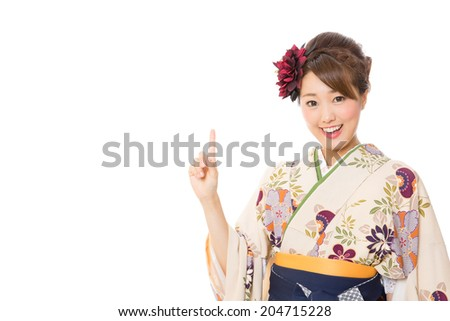 attractive asian woman wearing kimono on white background - stock photo
