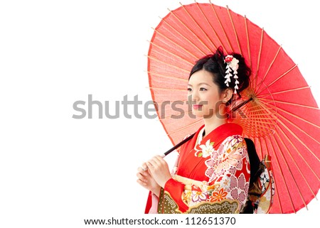 attractive asian woman wearing traditional japanese kimono and red umbrella on white background