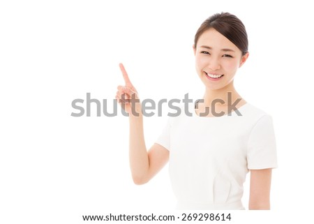 attractive asian woman wearing white clothes showing on white background - stock photo