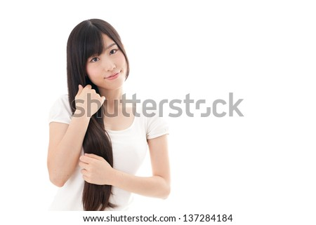 attractive asian woman with beautiful long hair on white background - stock photo