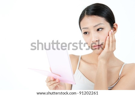 attractive asian woman with beautiful skin - stock photo