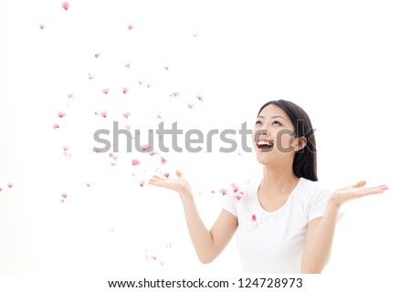 attractive asian woman with falling petals on white background