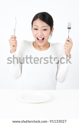 attractive asian woman with tableware isolated on white background - stock photo