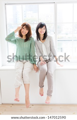 attractive asian women relaxing in the room - stock photo
