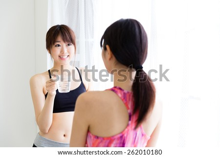 attractive asian women relaxing in the sport gym - stock photo