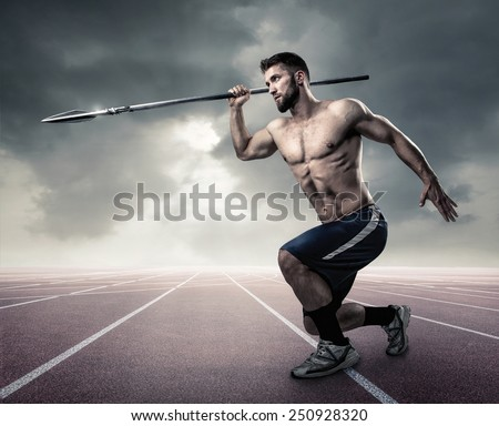 Attractive athlete with a spear - stock photo