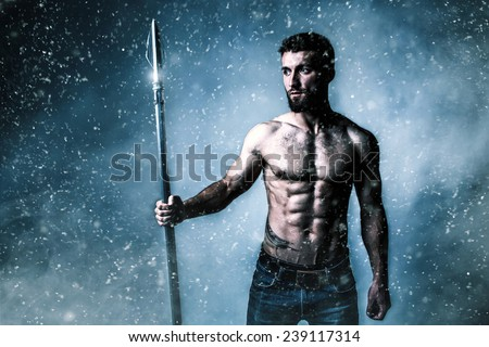 Attractive athlete with a weapon - stock photo