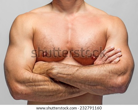 attractive athletic man on a grey background - stock photo