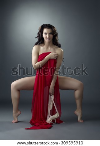 Attractive ballet dancer posing with red cloth - stock photo