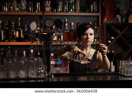 Attractive bartender with cocktail - stock photo