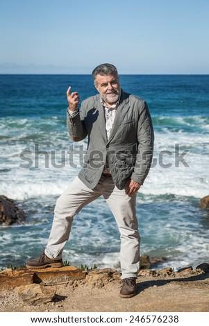 Attractive bearded man on the sea - stock photo