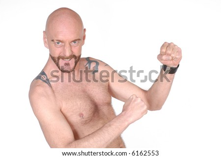 Attractive bearded middle aged man, aggressive attitude, display of power, firm expression on face - stock photo