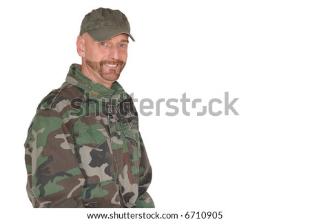 Attractive bearded middle aged  smiling soldier, pride expression on face - stock photo