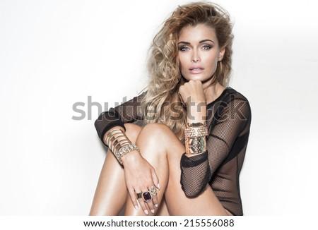 Attractive beautiful blonde woman posing, looking at camera. Studio shot - stock photo