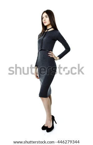 Attractive beautiful dark-haired woman wearing dress and belt on white background
