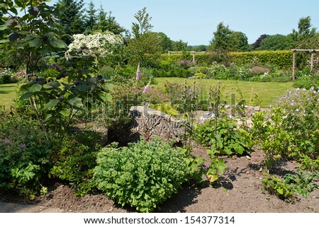 Attractive beautiful English style formal garden classical creative gardening - stock photo